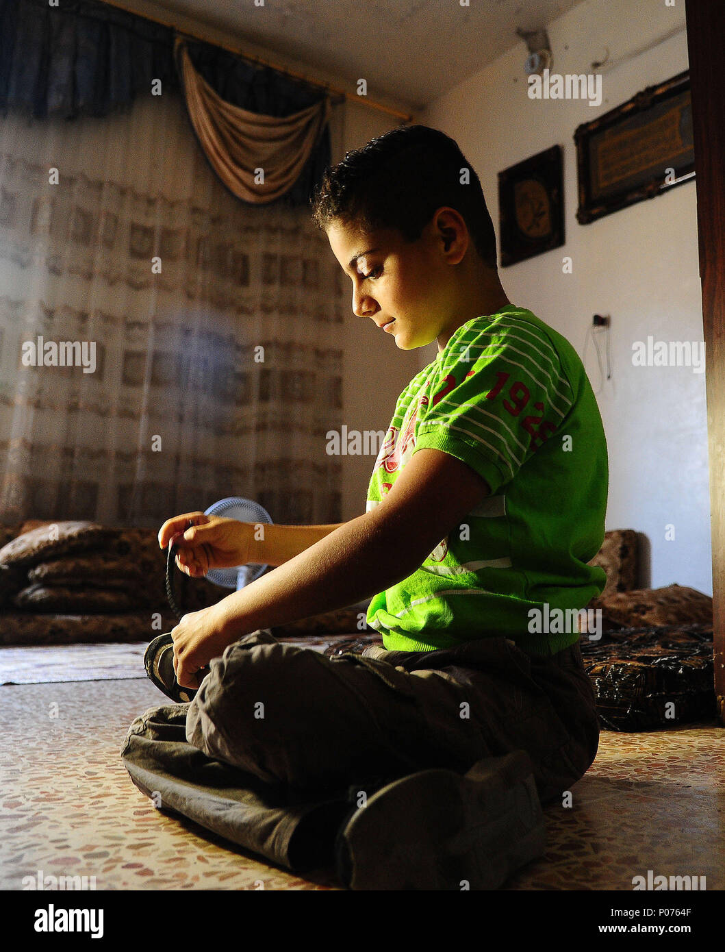 Abdullah Abduh Rahman Sits On The Ground In His House Aleppo City Northern Syria June 5 2018 A 10 Year Old Syrian Boy
