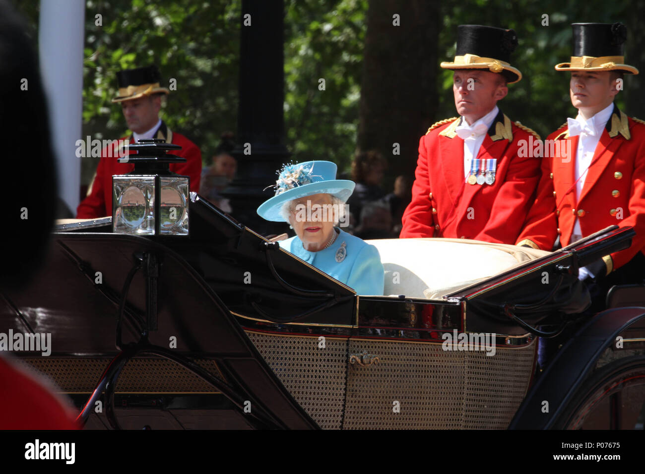 London, UK 9 June 2018: HMR Queen Elizabeth seen on horse-drawn carriage as they make their way to the Horse Guards Parade Ground on 9 June 2018. Over 1400 parading soldiers, 200 horses and 400 musicians come together each June in a great display of military precision, horsemanship and fanfare to mark The Queen's official birthday. Credit: David Mbiyu - Stock Image