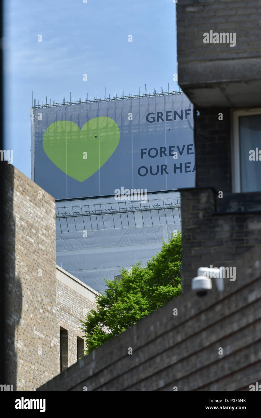 Shepherds Bush, London, UK. 9th June 2018. Grenfell Tower is now fully covered, green hearts cover the top, along with the phrase 'Grenfell Forever in Our Hearts', with the first anniversary of the fire  next week. Credit: Matthew Chattle/Alamy Live News - Stock Image