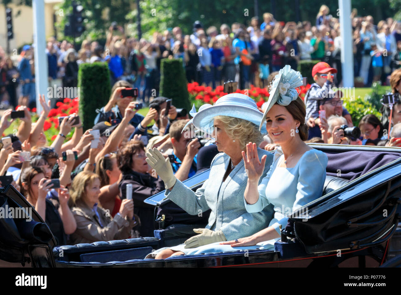 The Mall, London, UK, 9th June 2018. Catherine, Duchess of Cambridge and Camilla, Duchess of Cornwall in their carriage. The Sovereign's birthday is officially celebrated by the ceremony of Trooping the Colour, the Queen's Birthday Parade. Troops from the  Household Division, overall 1400 officers and soldiers are on parade, together with two hundred horses; over four hundred musicians from ten bands and corps of drums. The parade route extends from Buckingham Palace along The Mall to Horse Guards Parade, Whitehall and back again. Stock Photo