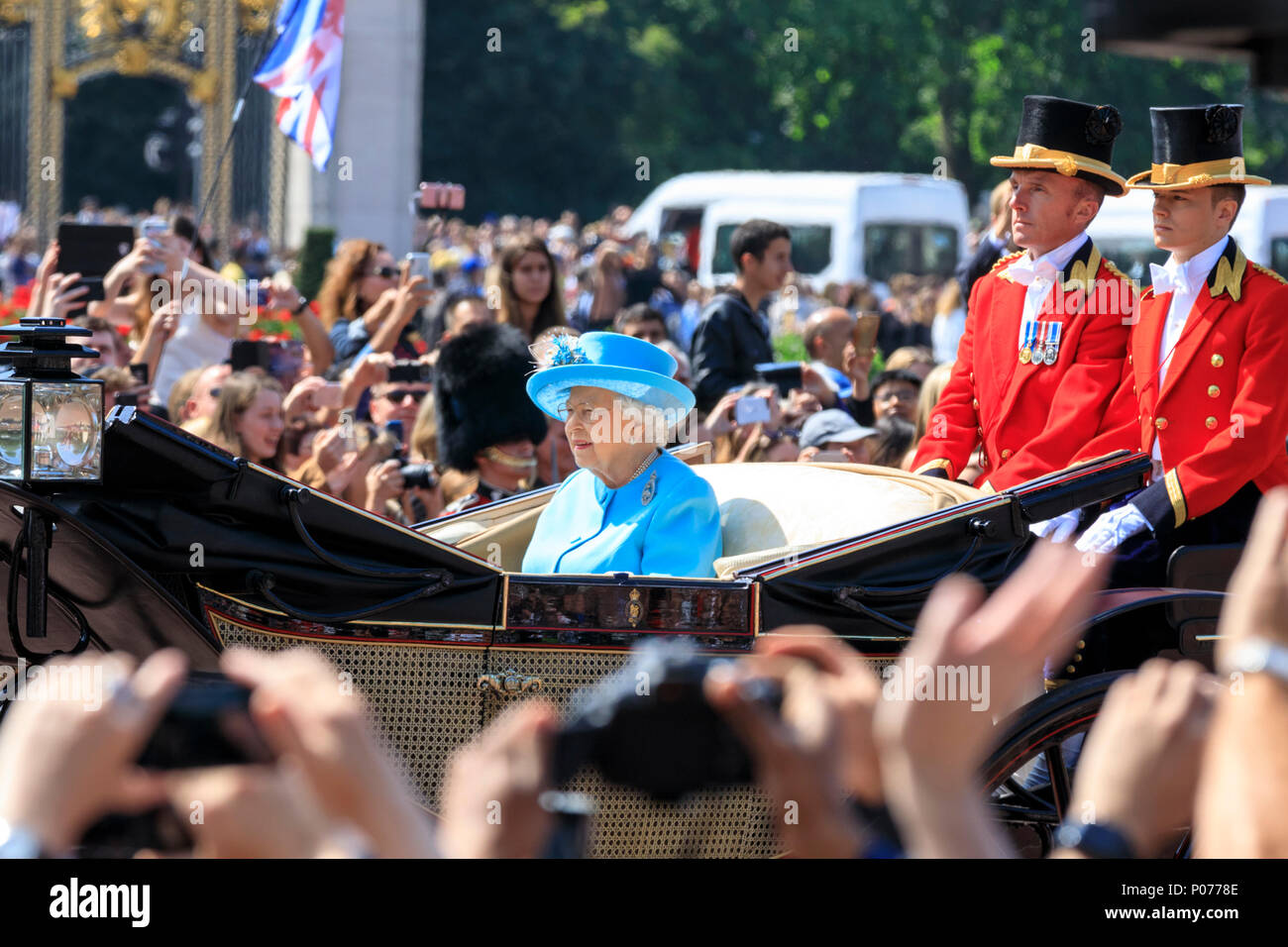 The Mall, London, UK, 9th June 2018. Her Majesty the Queen. The Sovereign's birthday is officially celebrated by the ceremony of Trooping the Colour, the Queen's Birthday Parade. Troops from the  Household Division, overall 1400 officers and soldiers are on parade, together with two hundred horses; over four hundred musicians from ten bands and corps of drums. The parade route extends from Buckingham Palace along The Mall to Horse Guards Parade, Whitehall and back again. Stock Photo