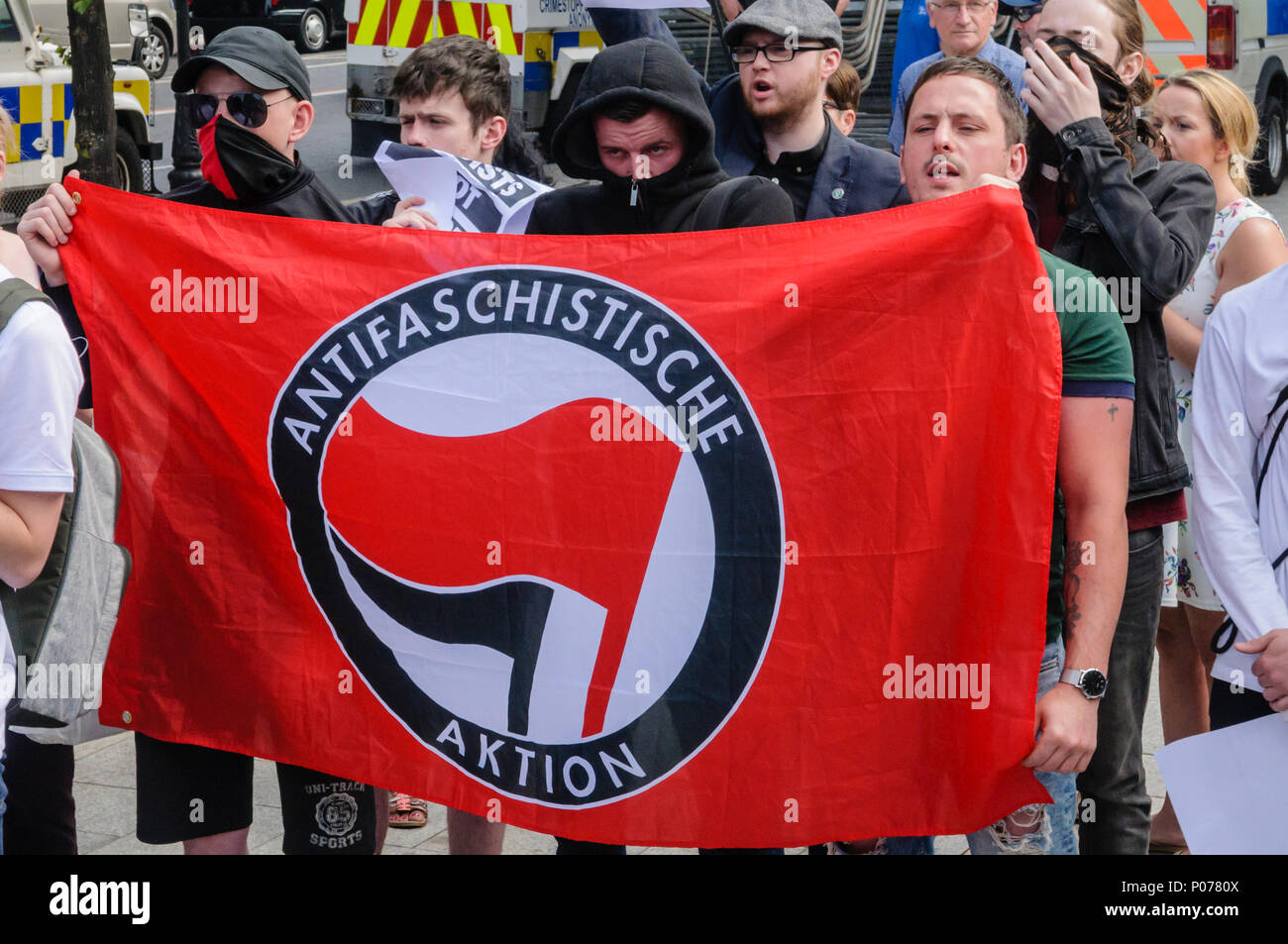 Belfast, Northern Ireland. 09/06/2018 - Northern Ireland Antifa members, many with their faces covered, protest against a rally in support of British First's Tommy Robinson, jailed in May 2018 for contempt of court. - Stock Image