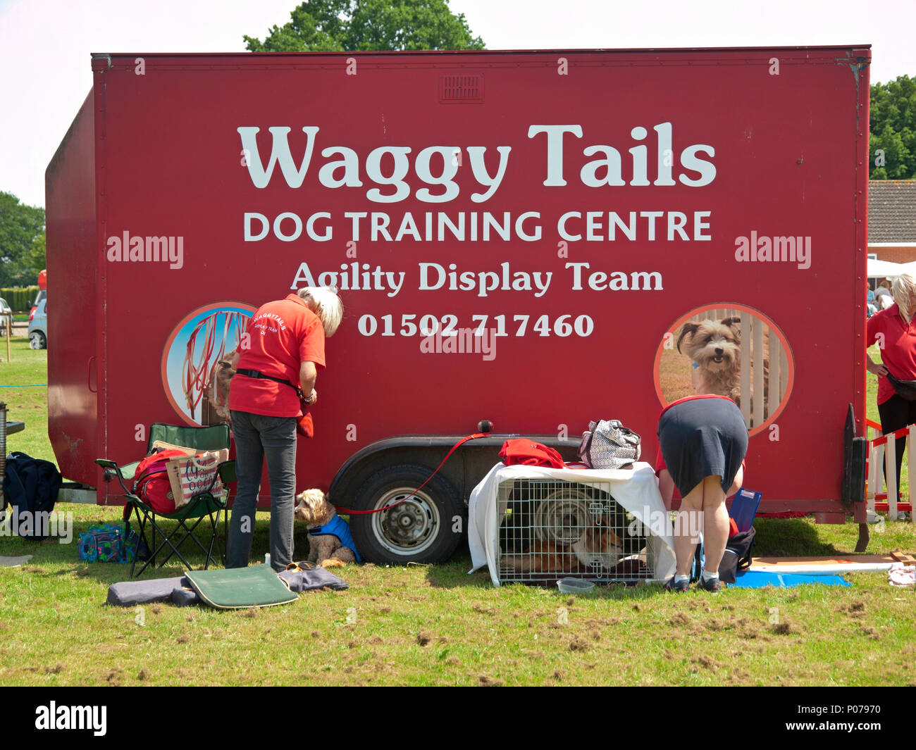 At a Suffolk village fete is parked the lorry of a dog display team - Stock Image
