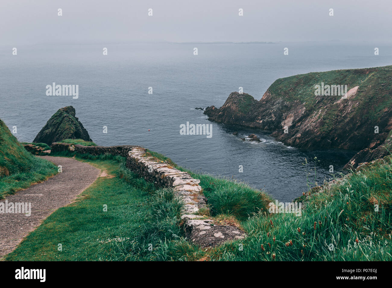 View from the iconic Dunquin harbour pier, the most westerly tip of the Dingle Peninsula in county Kerry, Ireland Stock Photo