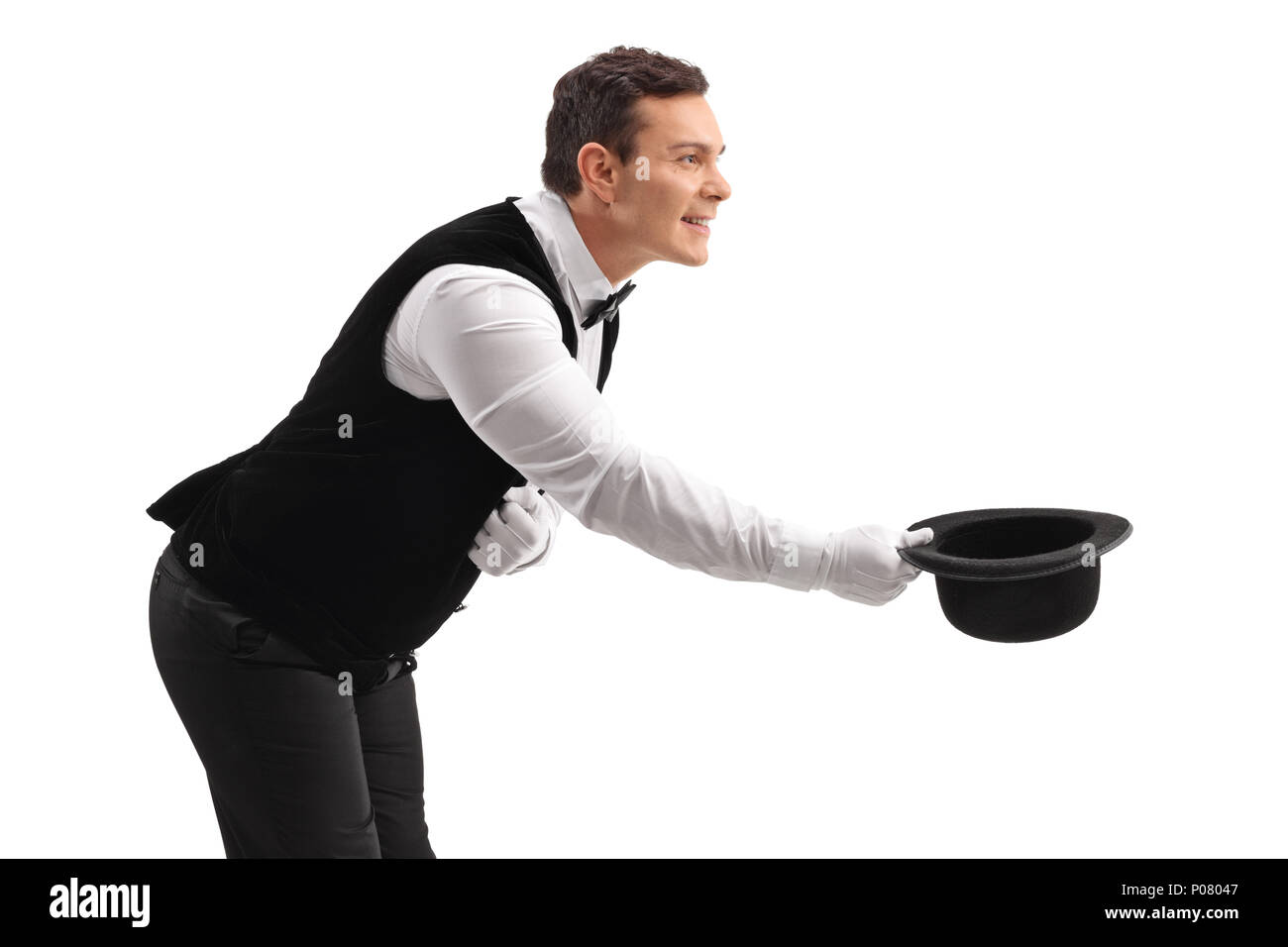 Waiter bowing down and taking his hat off isolated on white background - Stock Image