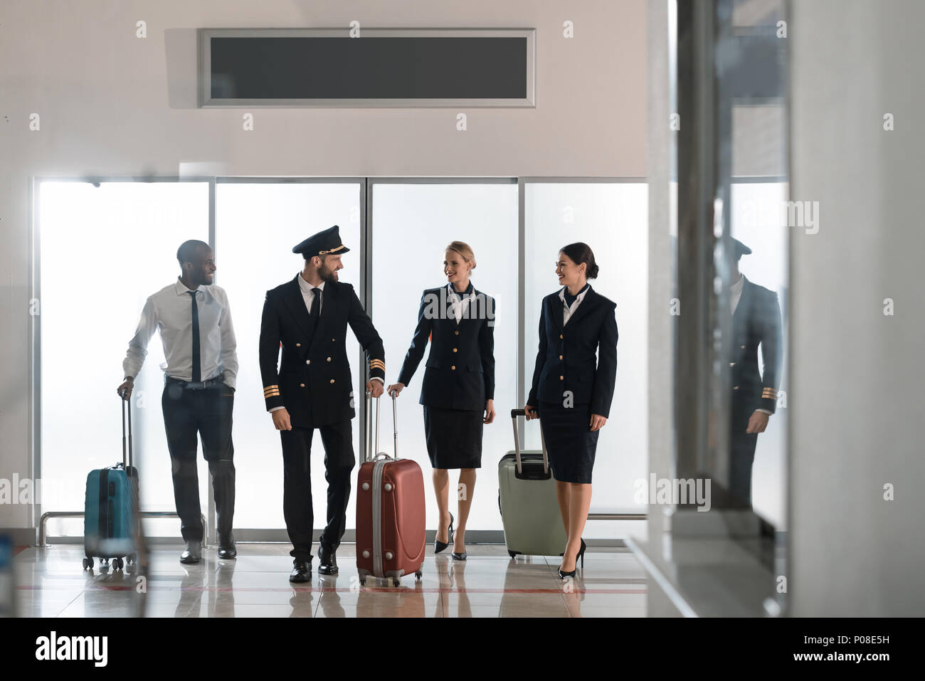 aviation personnel team walking by airport loggy - Stock Image