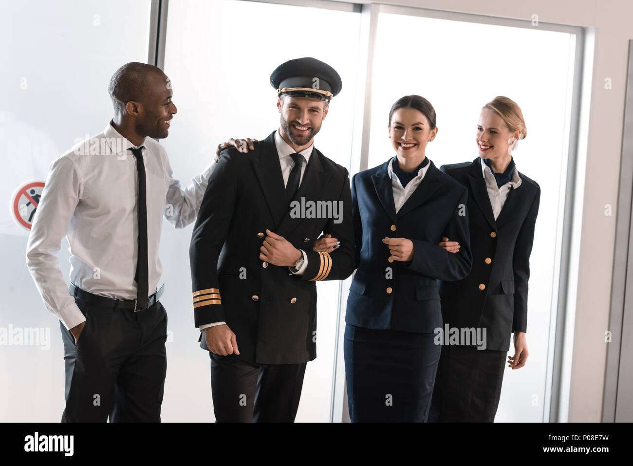 happy aviation personnel team in professional uniform - Stock Image
