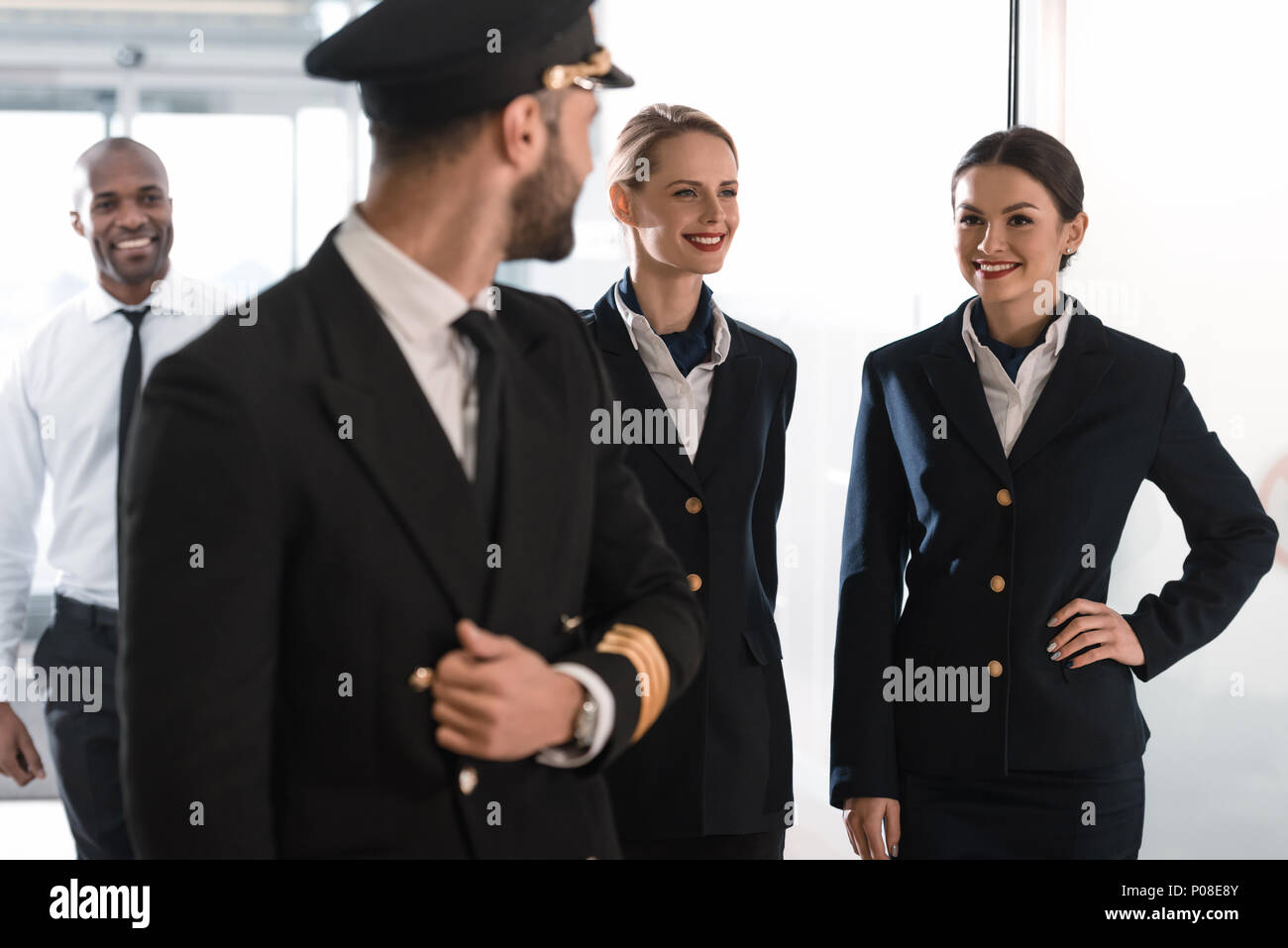 pilot and his team spending time in airport before flight - Stock Image