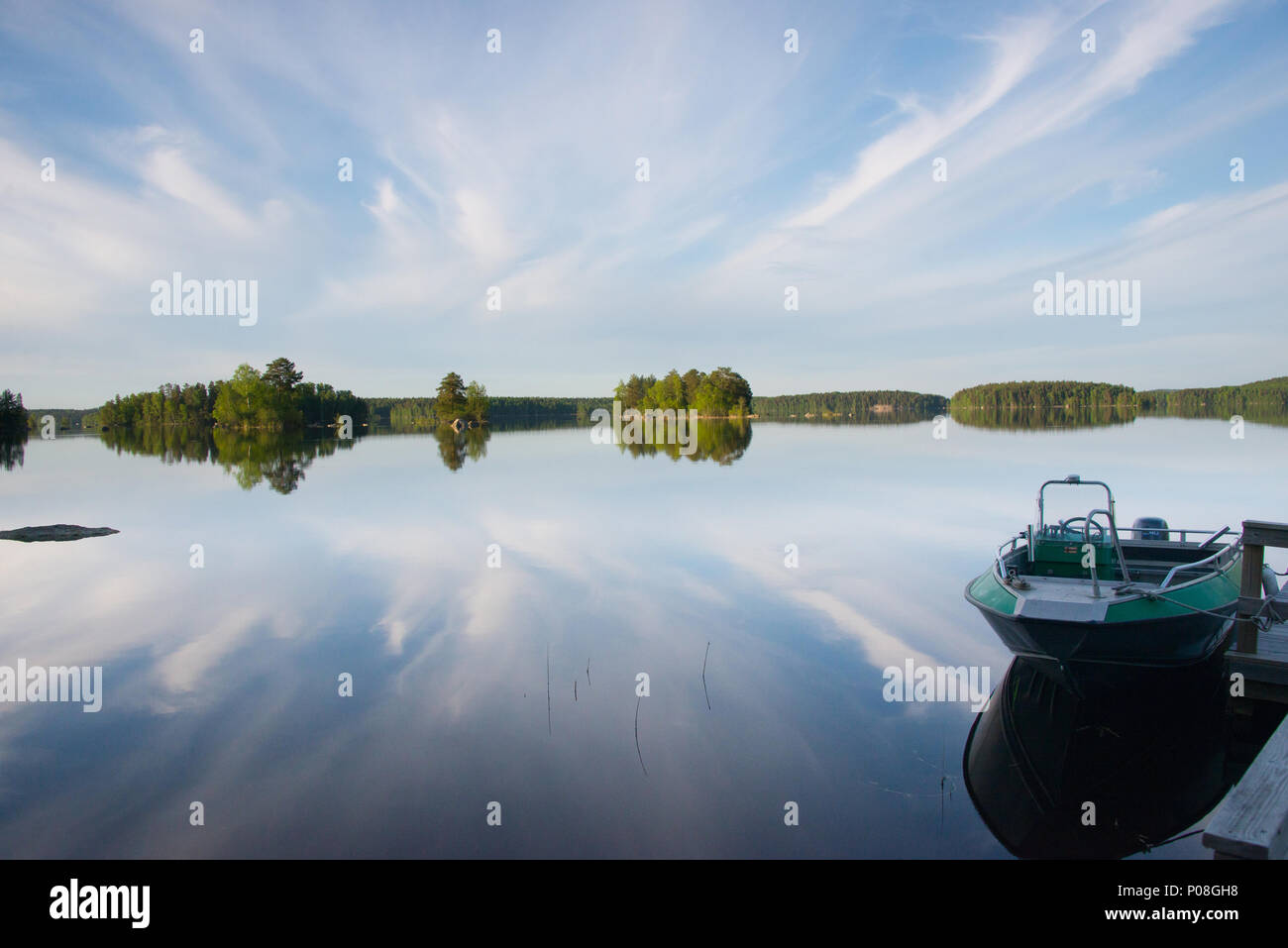 Cloud reflections. Lake Kukkia, Luopioinen, Finland. - Stock Image