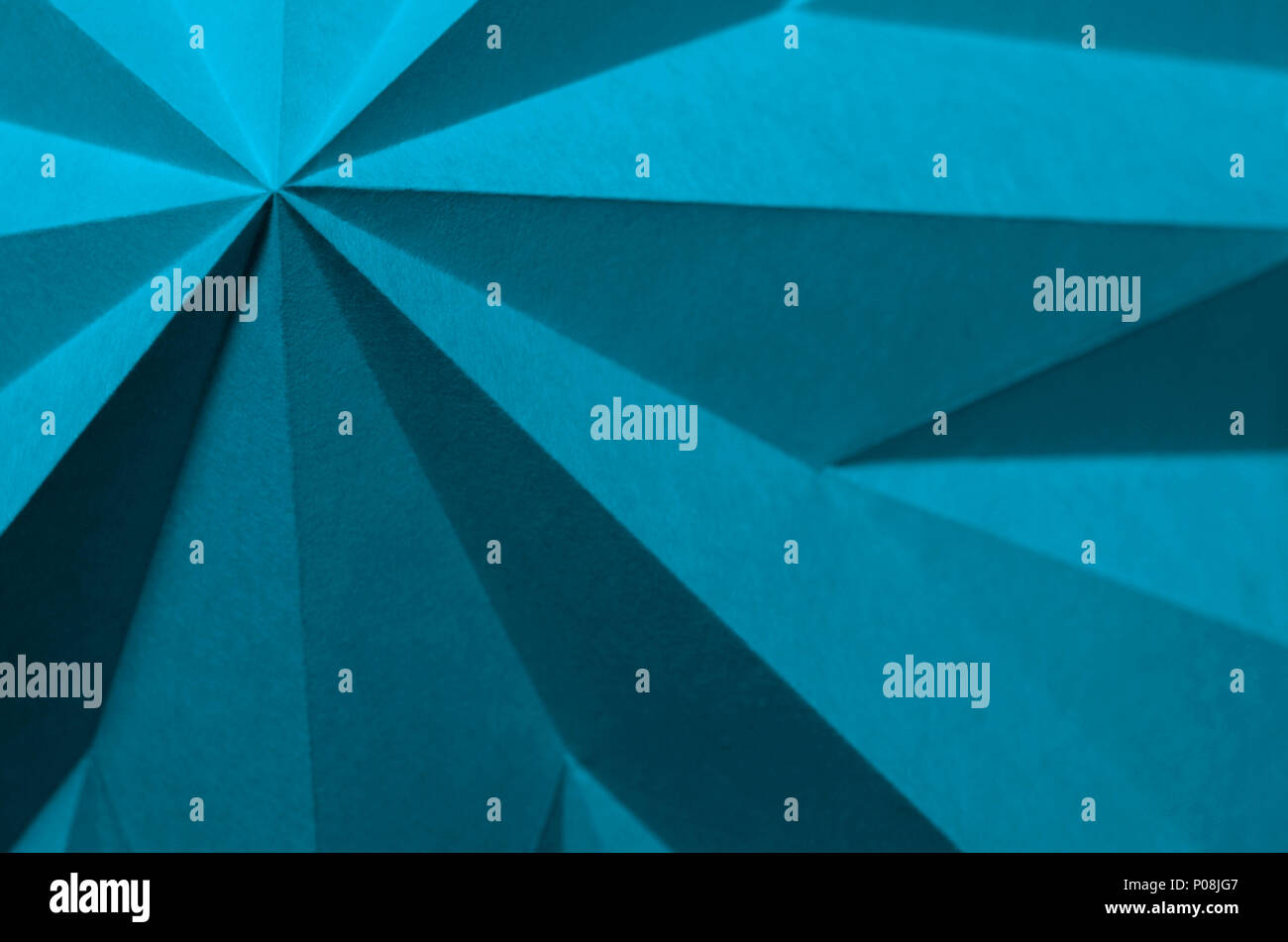 Blue Moon Pantone 17-4328. Blue monochrome abstract paper origami angular wallpaper background with negative space for titles. - Stock Image