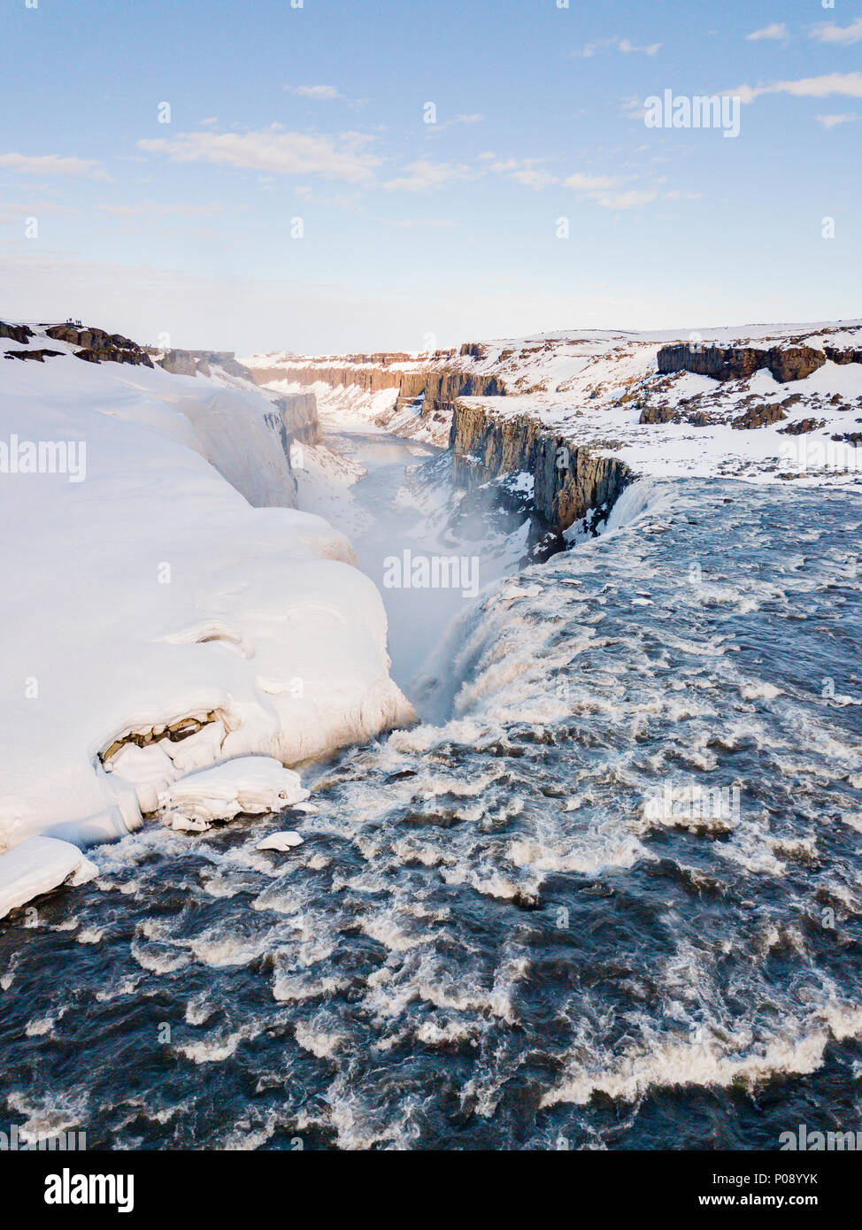 Aerial view, snowy landscape, gorge, canyon with falling water masses, Dettifoss waterfall in winter, Northern Iceland, Iceland - Stock Image