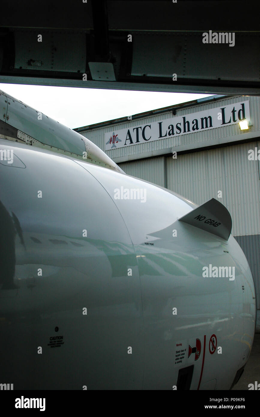 ATC Lasham Ltd aircraft engineering company at London Southend Airport. Framed by Airbus A320 jet plane engine and wing - Stock Image