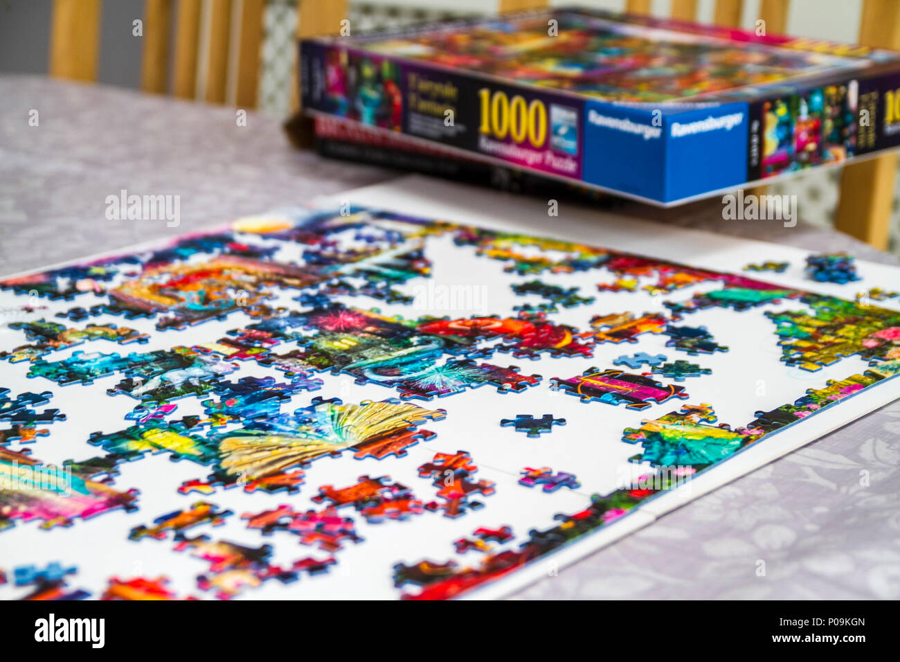 Large 1000 piece jigsaw puzzle pieces, multi colour, colourful educational family fun Stock Photo