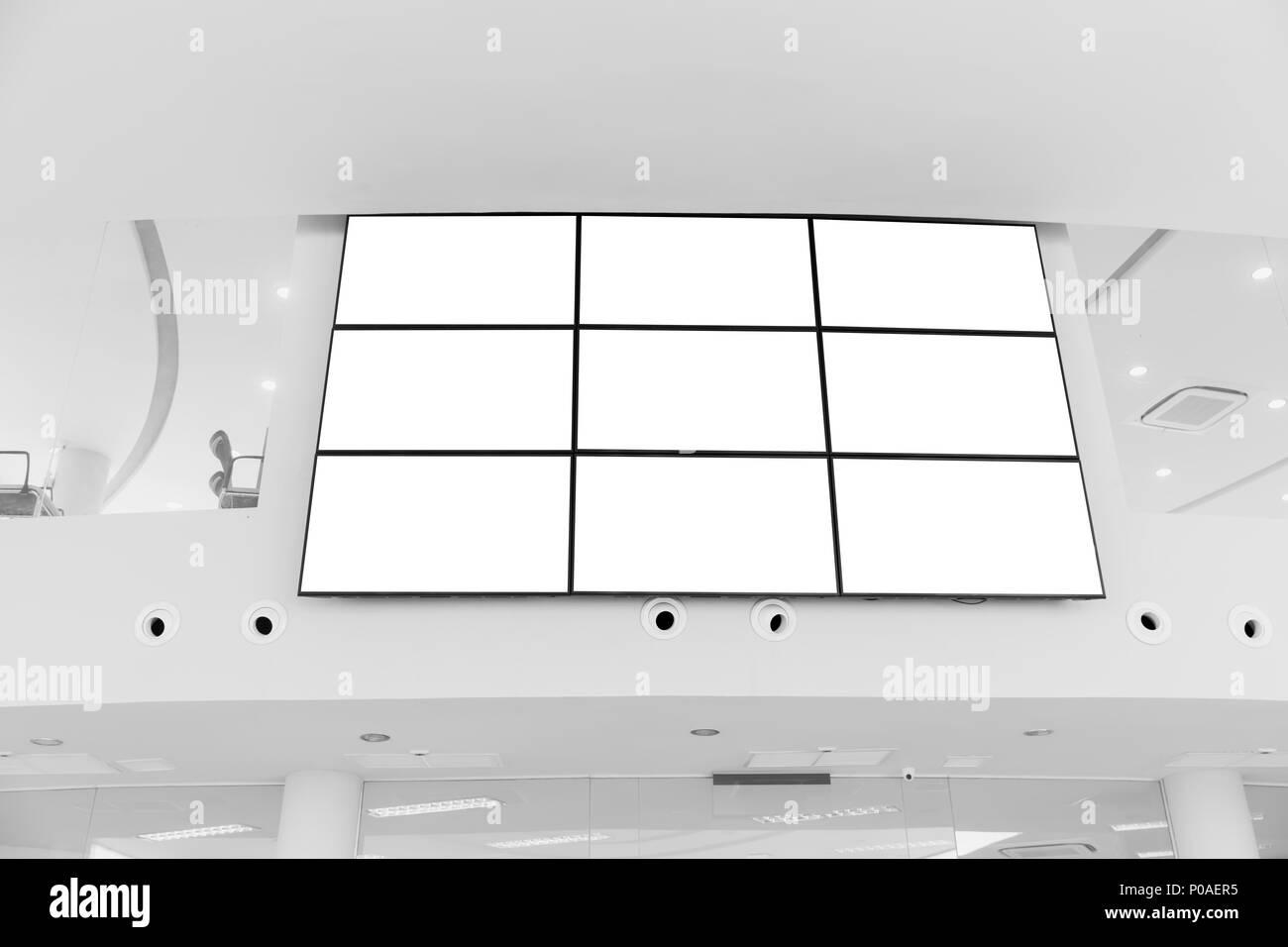 Video wall LED screen array billboard setup installation indoor office hall - Stock Image