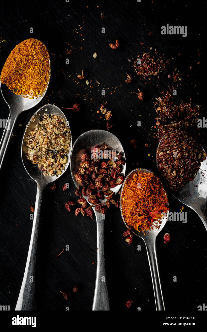 spices on spoons view from above - Stock Image