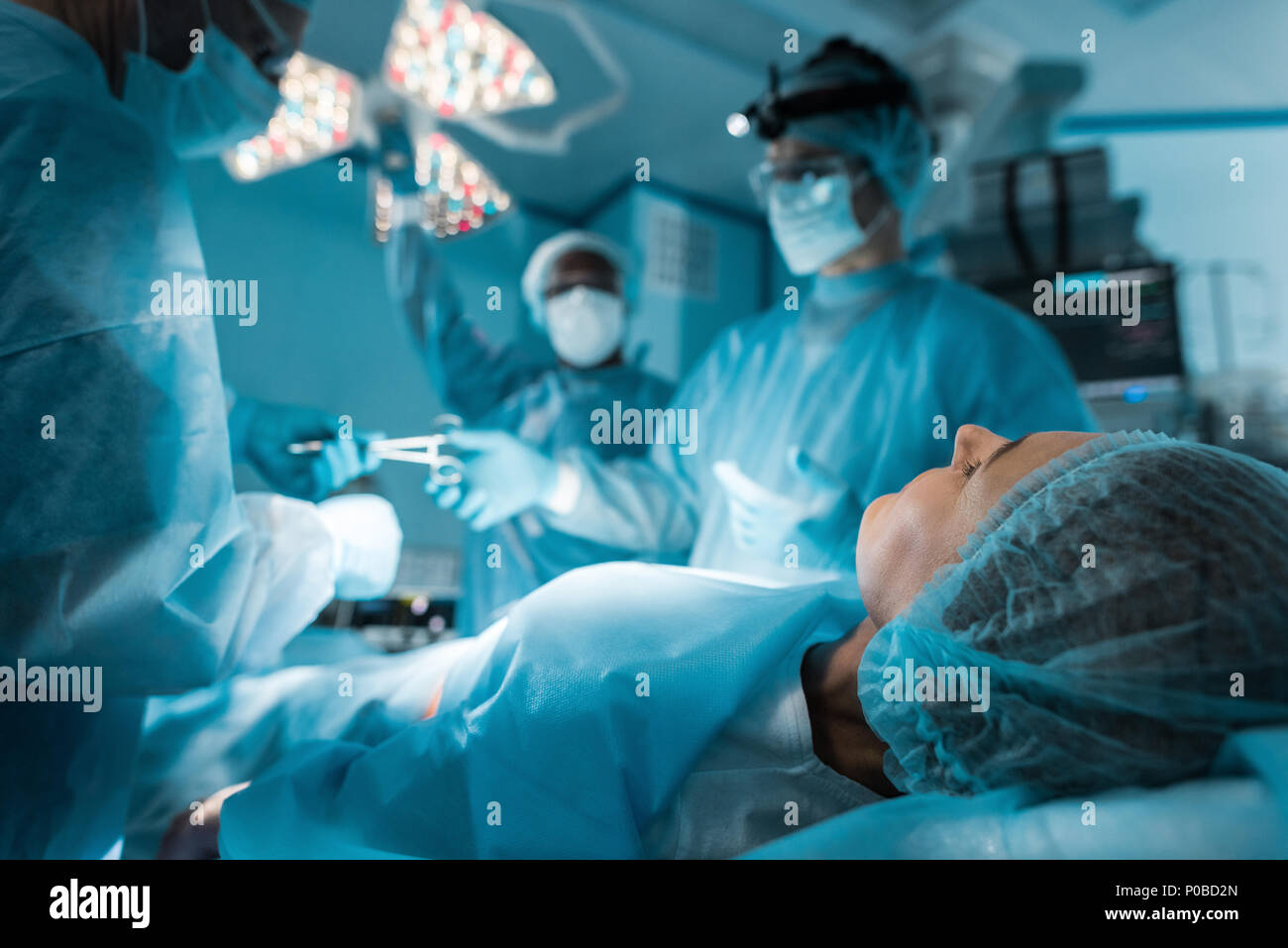 patient lying on operating table during surgery - Stock Image