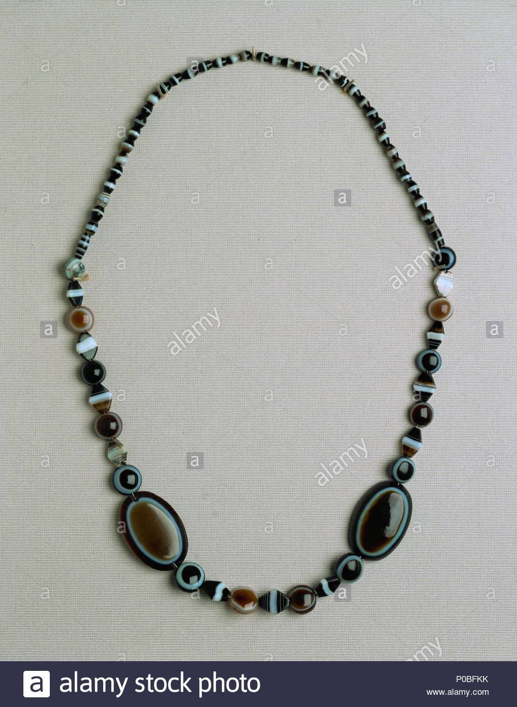 necklace of gold pearls with agate cornelian and lapis lazuli