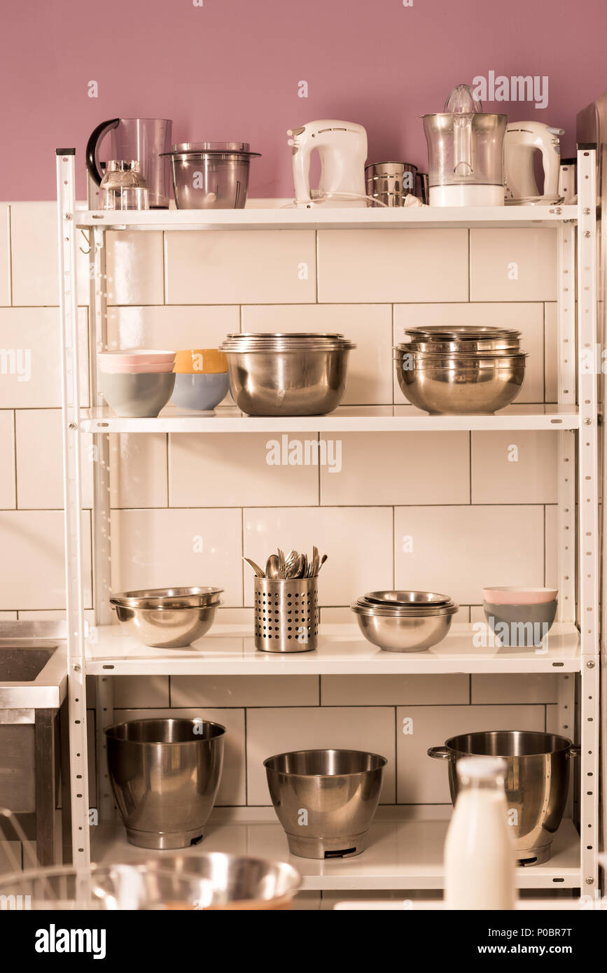 Close Up View Of Various Kitchen Supplies On Shelves In Restaurant Kitchen Stock Photo Alamy