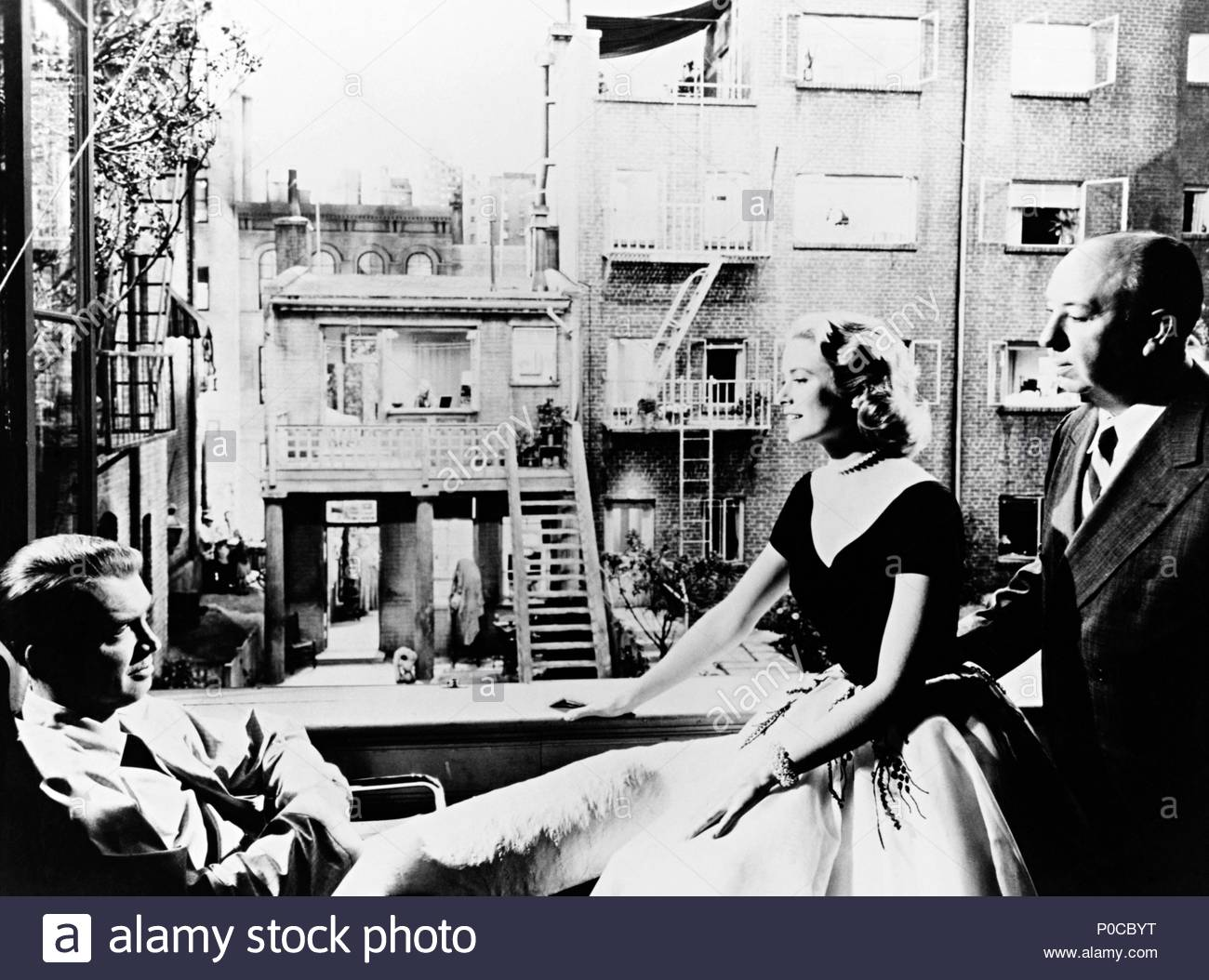 Original Film Title: REAR WINDOW.  English Title: REAR WINDOW.  Film Director: ALFRED HITCHCOCK.  Year: 1954.  Stars: JAMES STEWART; GRACE KELLY; ALFRED HITCHCOCK. Credit: PARAMOUNT PICTURES / Album - Stock Image