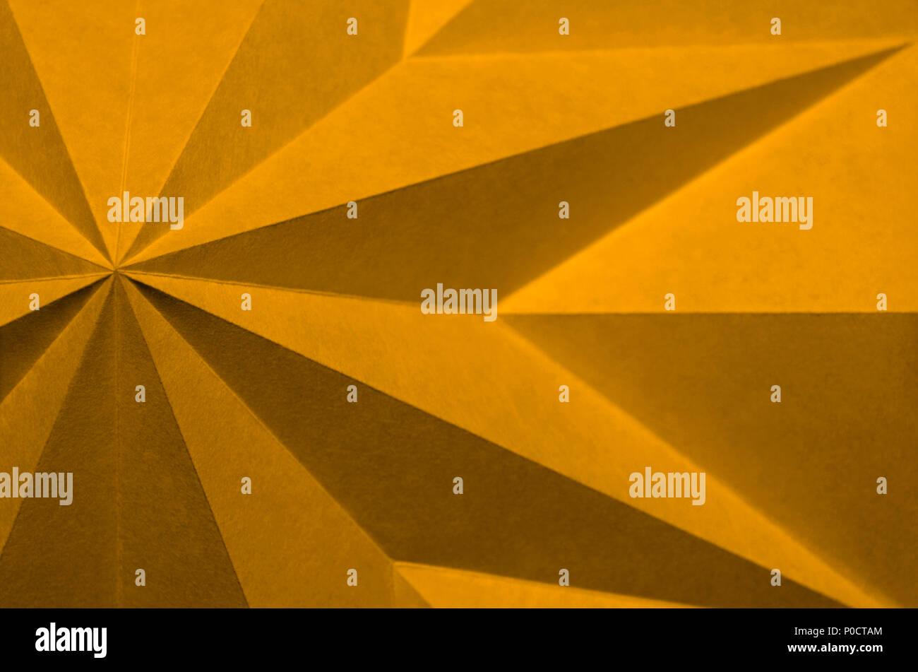 orange, Citrus Pantone 14-0955, Origami; folded paper texture, one colour, one colour, close up,macro abstract, angular design element. - Stock Image