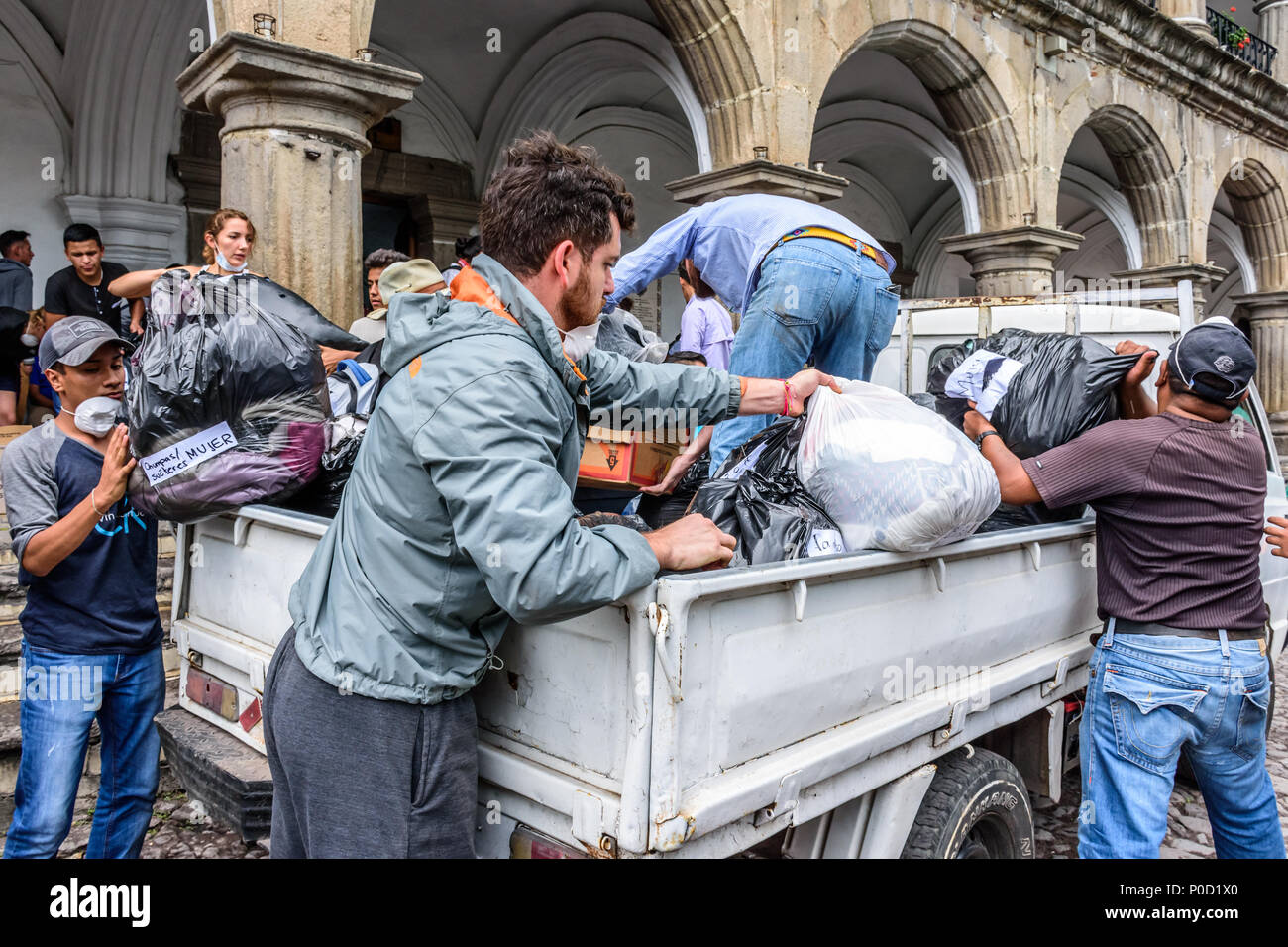 Antigua,, Guatemala -  June 5, 2018:  Volunteers load humanitarian aid supplies to take to area affected by eruption of Fuego (fire) volcano on June 3 - Stock Image
