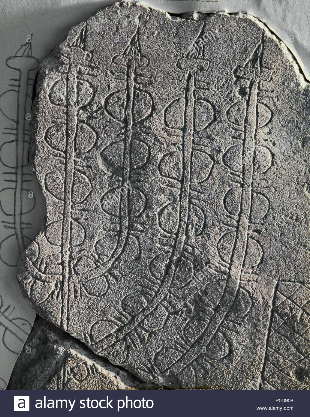 Drawing of a menorah (height 20 cm) on a stone. Probably the oldest representation of a Temple Menorah. The 2nd Temple was destroyed in 70 CE. Location: Israel Museum (IDAM), Jerusalem, Israel. - Stock Image