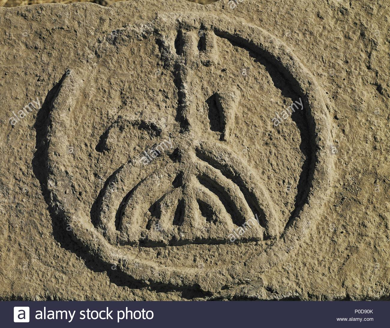 Menorah medallion in relief on a lintel from the ruins of the synagogue of Aphek, a village in the Golan Heights east of the Sea of Galilee, Israel. Location: Golan Museum, Kazrin, Israel. - Stock Image