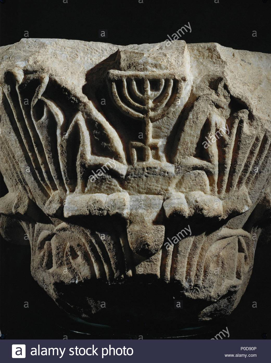 Stone capital showing a menorah carved in relief among acanthus leaves. From a synagogue at Caesarea, Israel. Location: Israel Museum (IDAM), Jerusalem, Israel. - Stock Image