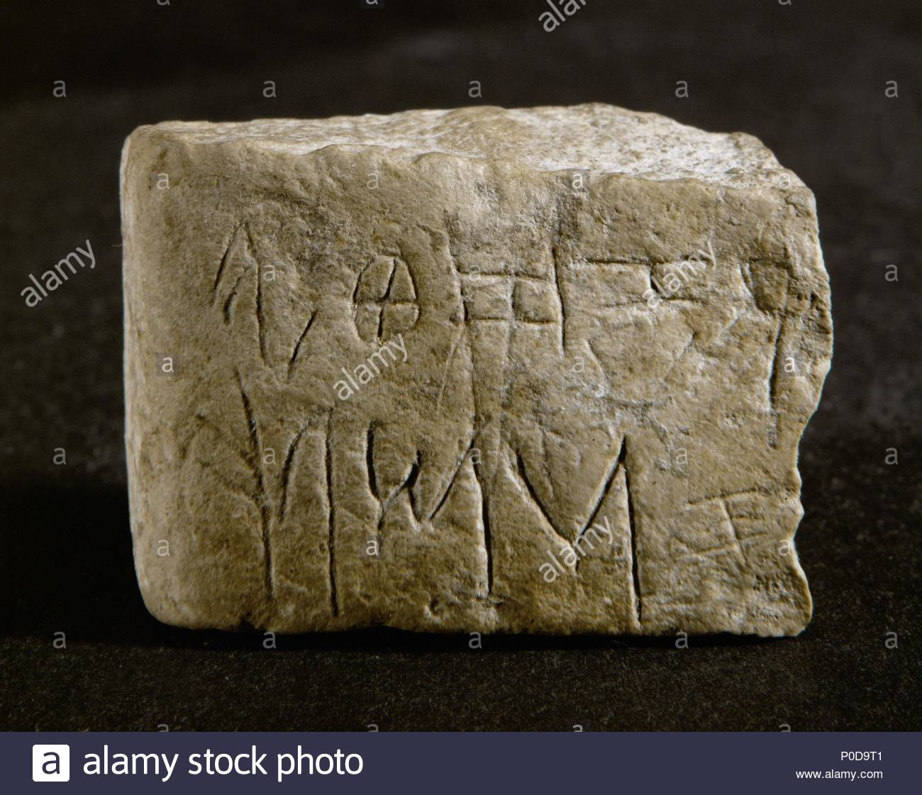 Part of a Hebrew alphabet tablet with ten letters, Shin to R, found near Hebron, Israel. Stone, Early Iron Age II 3 x 1.7 x 4.2 cm-Inv. H 815. Location: Reuben and Edith Hecht Collection-University, Haifa, Israel. - Stock Image