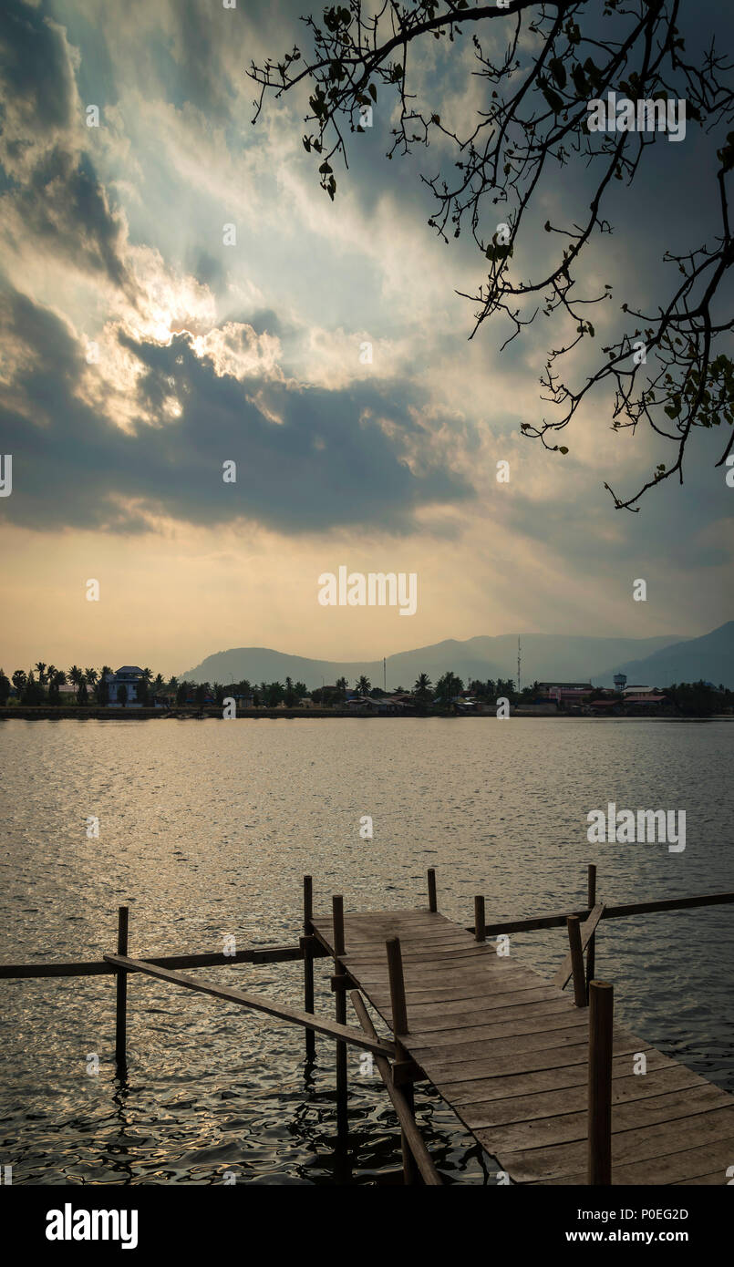 pier and river landscape view at sunset in kampot town cambodia - Stock Image