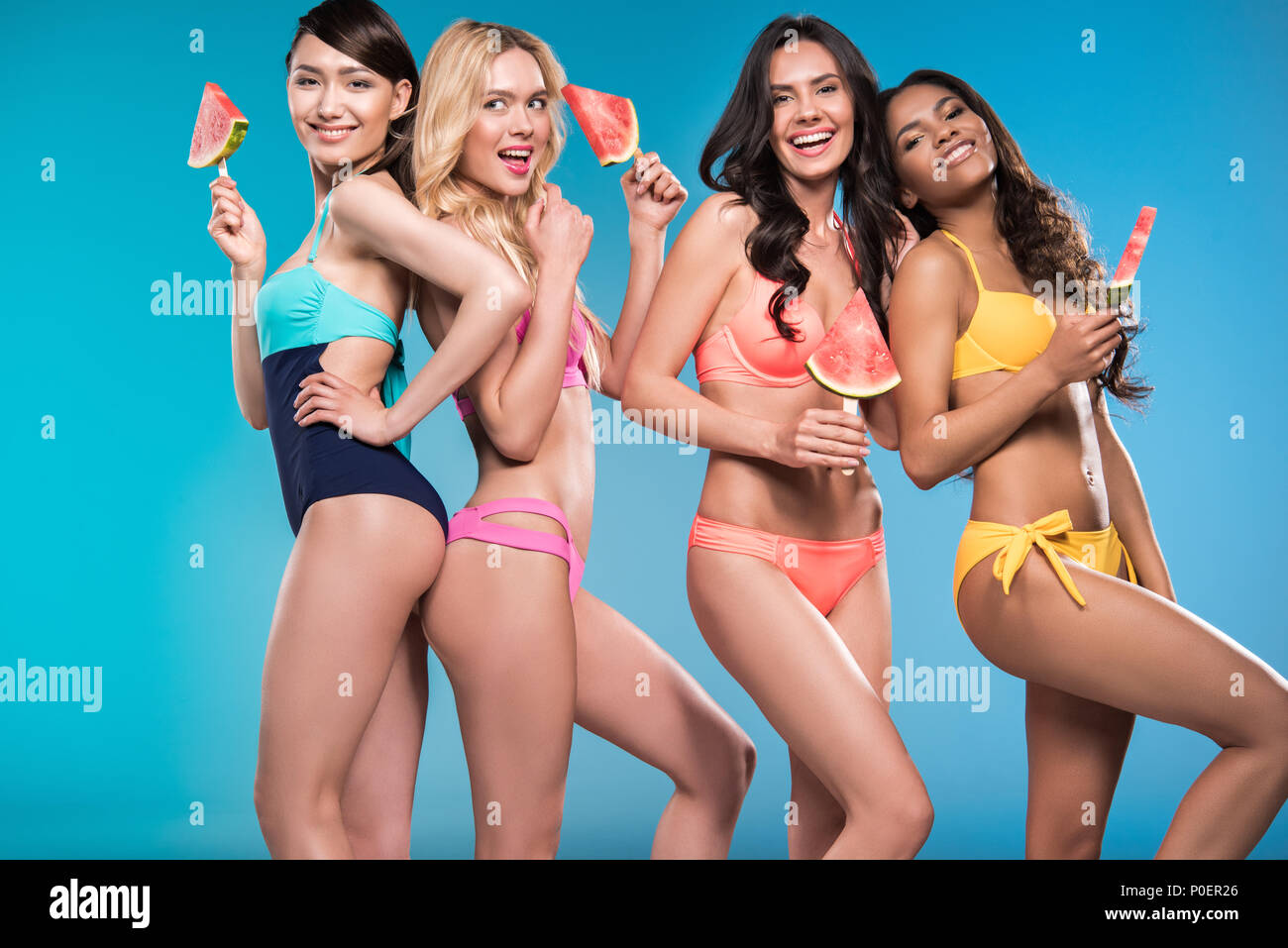 a8eb7394b0 attractive women in swimsuits smiling and posing with watermelon pieces -  Stock Image