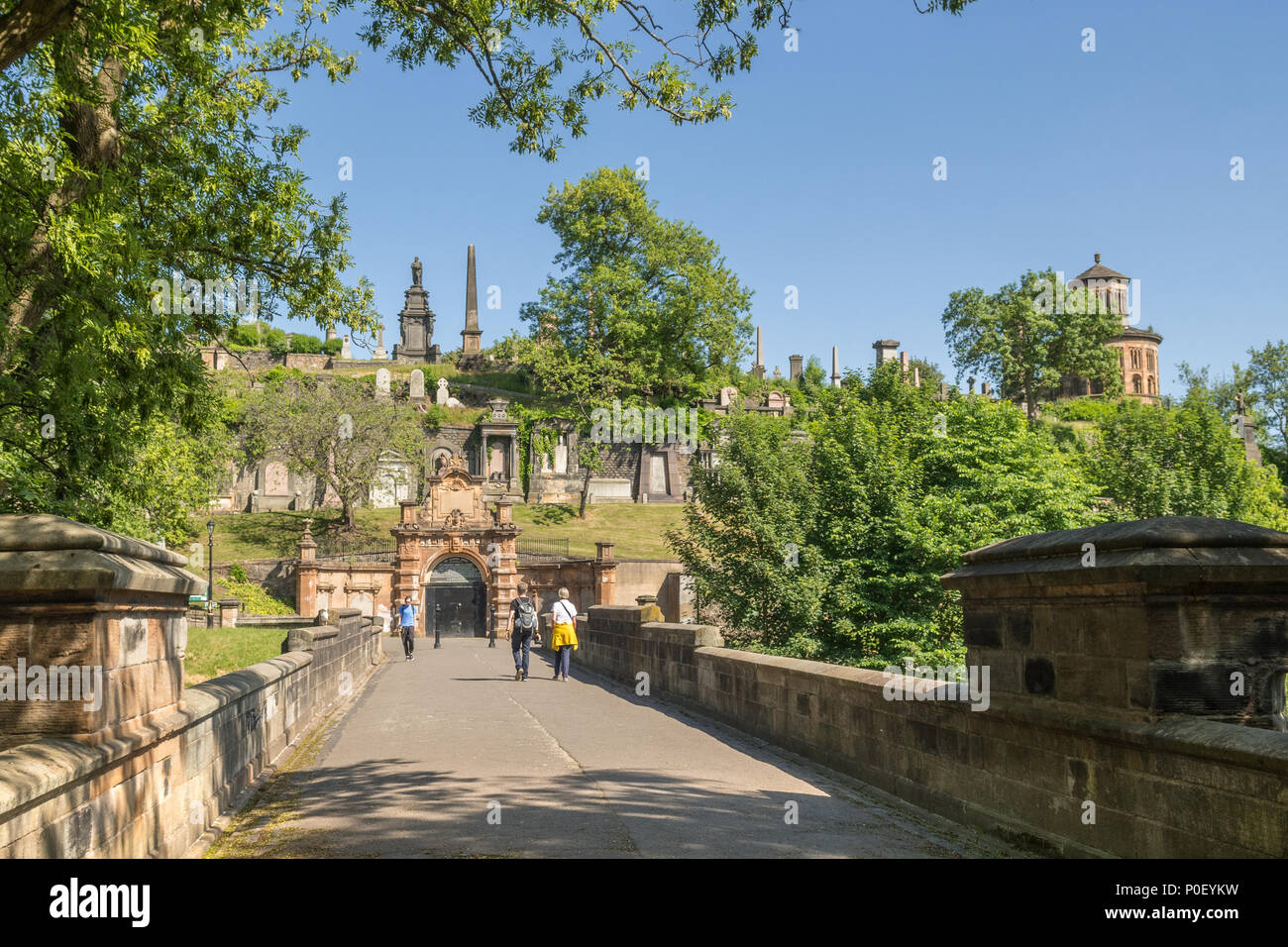 people walking over the Bridge of Sighs entering Glasgow Necropolis, victorian cemetery, Glasgow, Scotland, UK Stock Photo