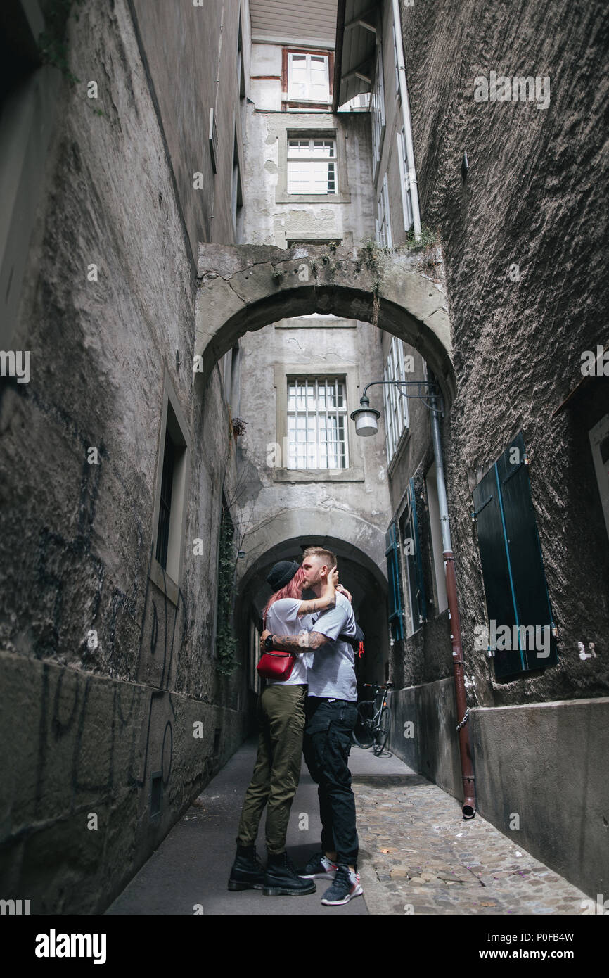 young couple in love kissing on cozy narrow street in Bern, Switzerland - Stock Image