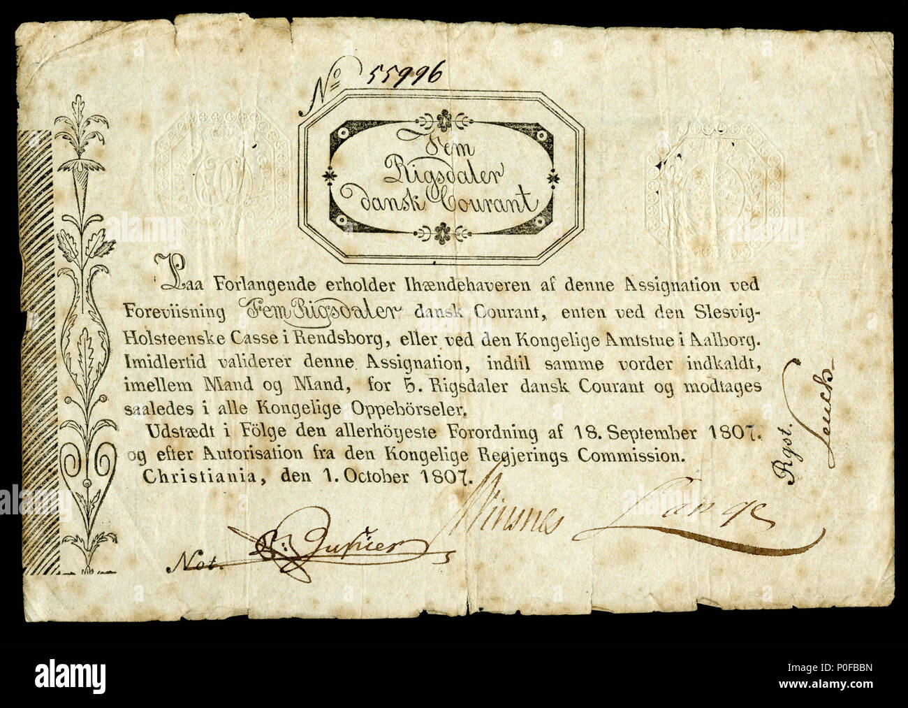 . English: Kingdom of Norway, Regerings Kommission, 5 Rigsdaler Courant (1807). Norway circulated one issue of paper currency in 1695 and following a hiatus of just over a century, resumed issuing banknotes in 1807. 'On request, relieve the bearer of this instrument by presenting five rigsdaler dansk courant, either through the Schleswig-Holstein Cashier's Office in Rendsborg or through the Royal District Office in Aalborg. Meanwhile validate this instrument until the same be called for, between man and man, for five rigsdaler dansk courant and receive it thus in all Royal revenues. Issued acc Stock Photo