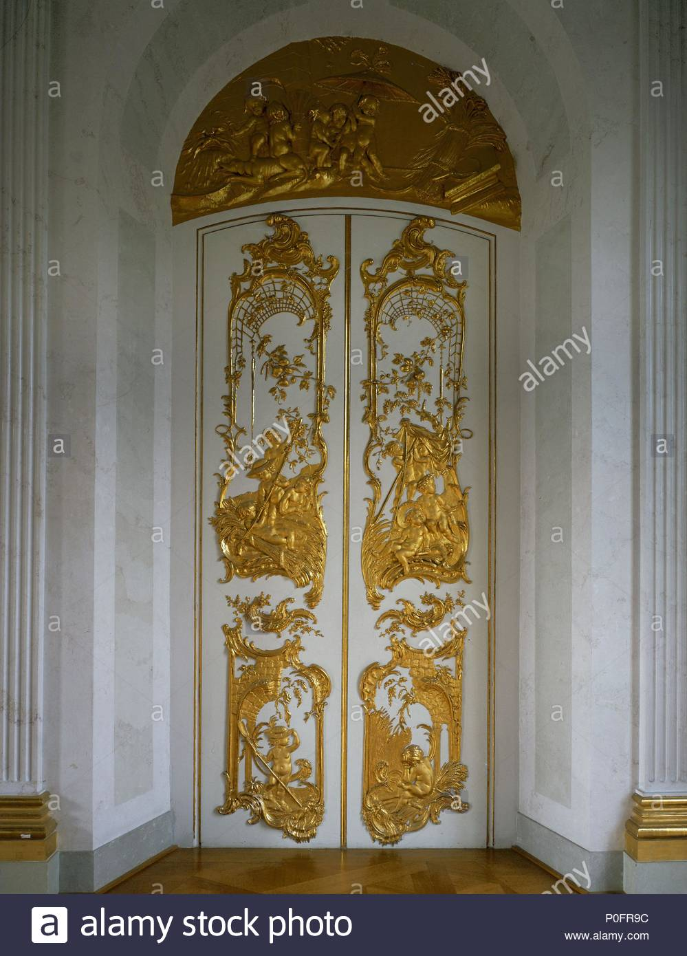 sham door with richly gilded stucco work in the white gallery of