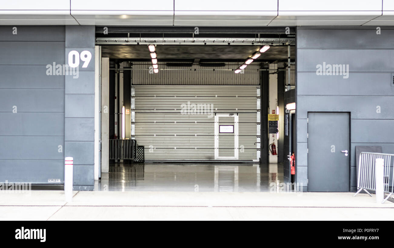 SILVERSTONE UK - JUNE 8, 2018: Empty Pit Garage at the Silverstone Grand Prix Circuit - Stock Image