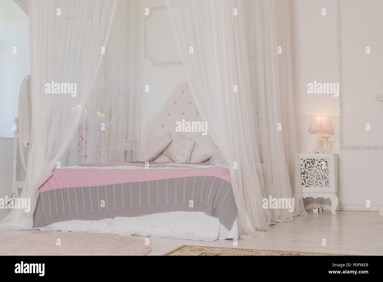 Bedroom In Soft Light Colors With A Wooden Floor Big Comfortable Four Poster Double Bed In Elegant Classic Bedroom Natural White With Wood Interior Design Large Bed Stock Photo Alamy