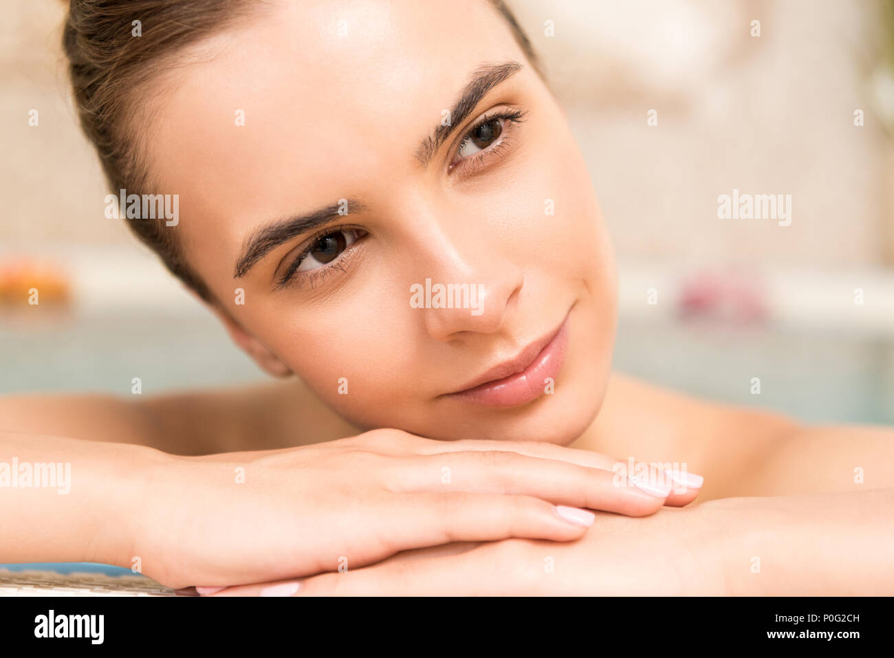 smiling gorgeous woman relaxing in spa - Stock Image