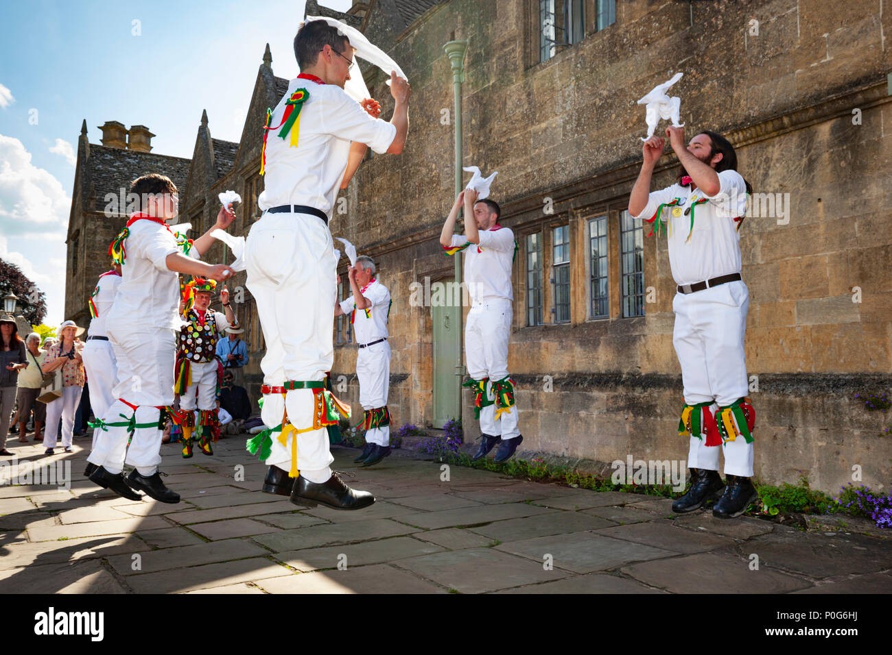 Morris dance outside the Chipping Campden Almshouses during the Scuttlebrook Wake, Chipping Campden, Cotswolds, Gloucestershire, England, UK - Stock Image