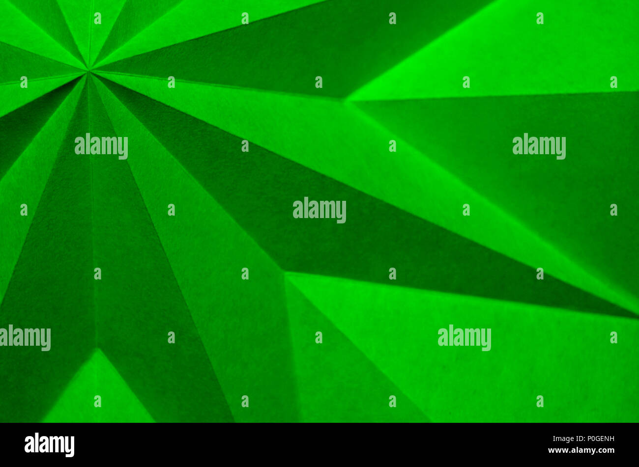 Green origami abstract Christmas wallpaper background. 100% green, no red no blue. Design element for holiday background. - Stock Image