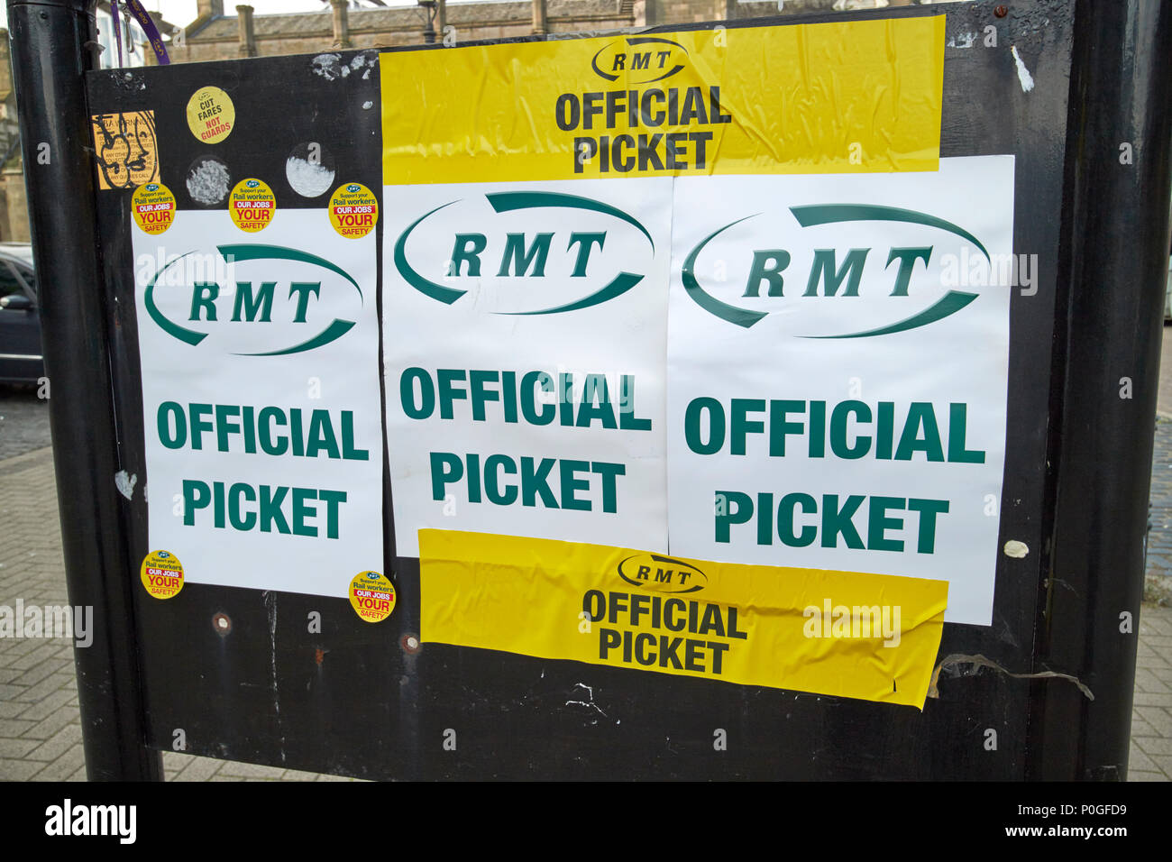 RMT union official picket signs outside Carlisle train station Cumbria England UK - Stock Image