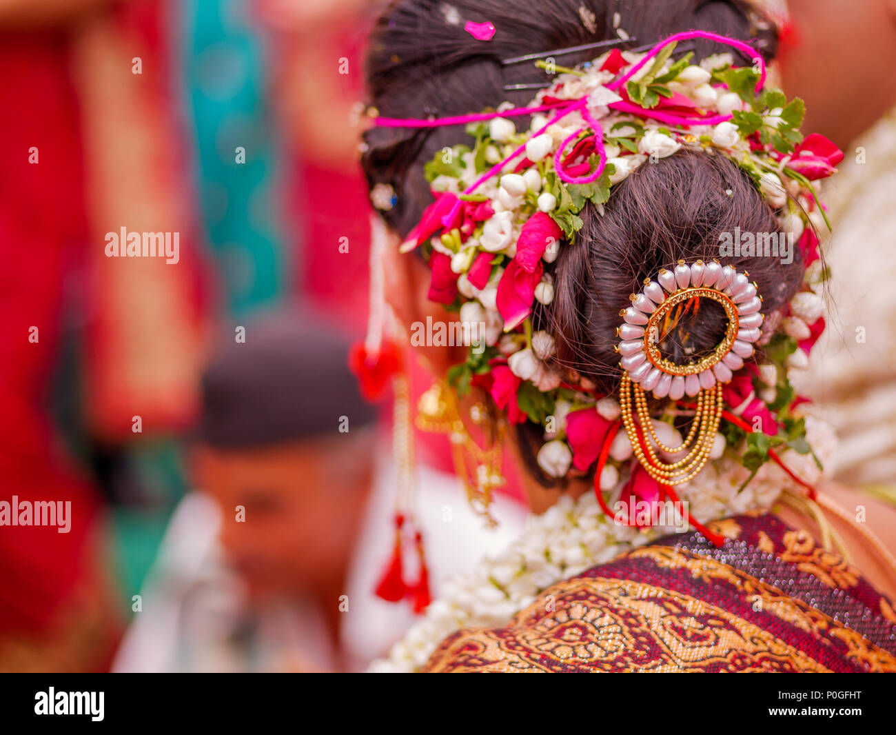The close up shot of indian maharashtrian bride with beautiful hair the close up shot of indian maharashtrian bride with beautiful hair style decorated with flowers izmirmasajfo