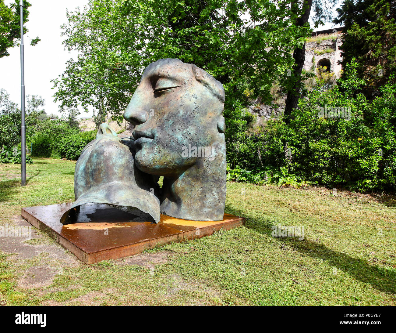 A sculpture of 2 large human heads at the Pompeii Archaeological site, Pompeii, Campania, Italy, - Stock Image