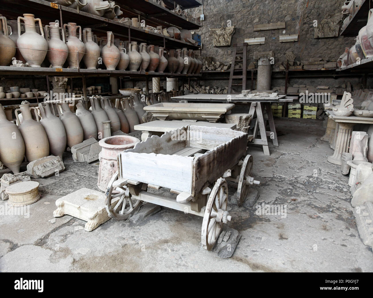 A wooden cart and pottery amphora preserved in the ash at the Pompeii Archaeological site, Pompeii, Campania, Italy, - Stock Image
