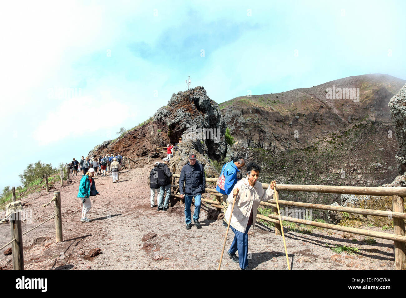 People walking up Vesuvius, Mount Vesuvius or Vesuvio, an active volcano that rises above the Bay of Naples on the plain of Campania in Italy Stock Photo