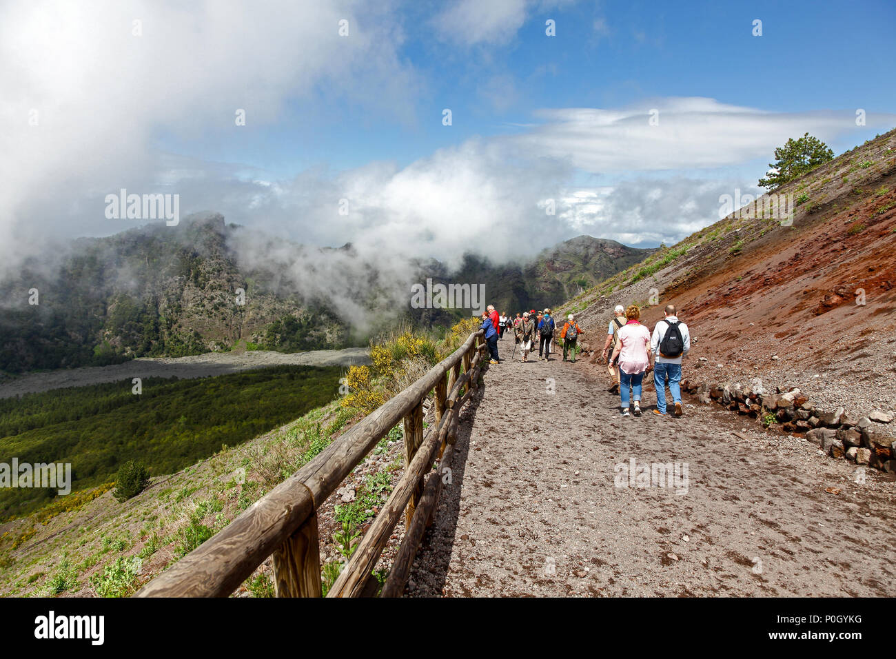 People walking up Vesuvius, Mount Vesuvius or Vesuvio, an active volcano that rises above the Bay of Naples on the plain of Campania in Italy - Stock Image