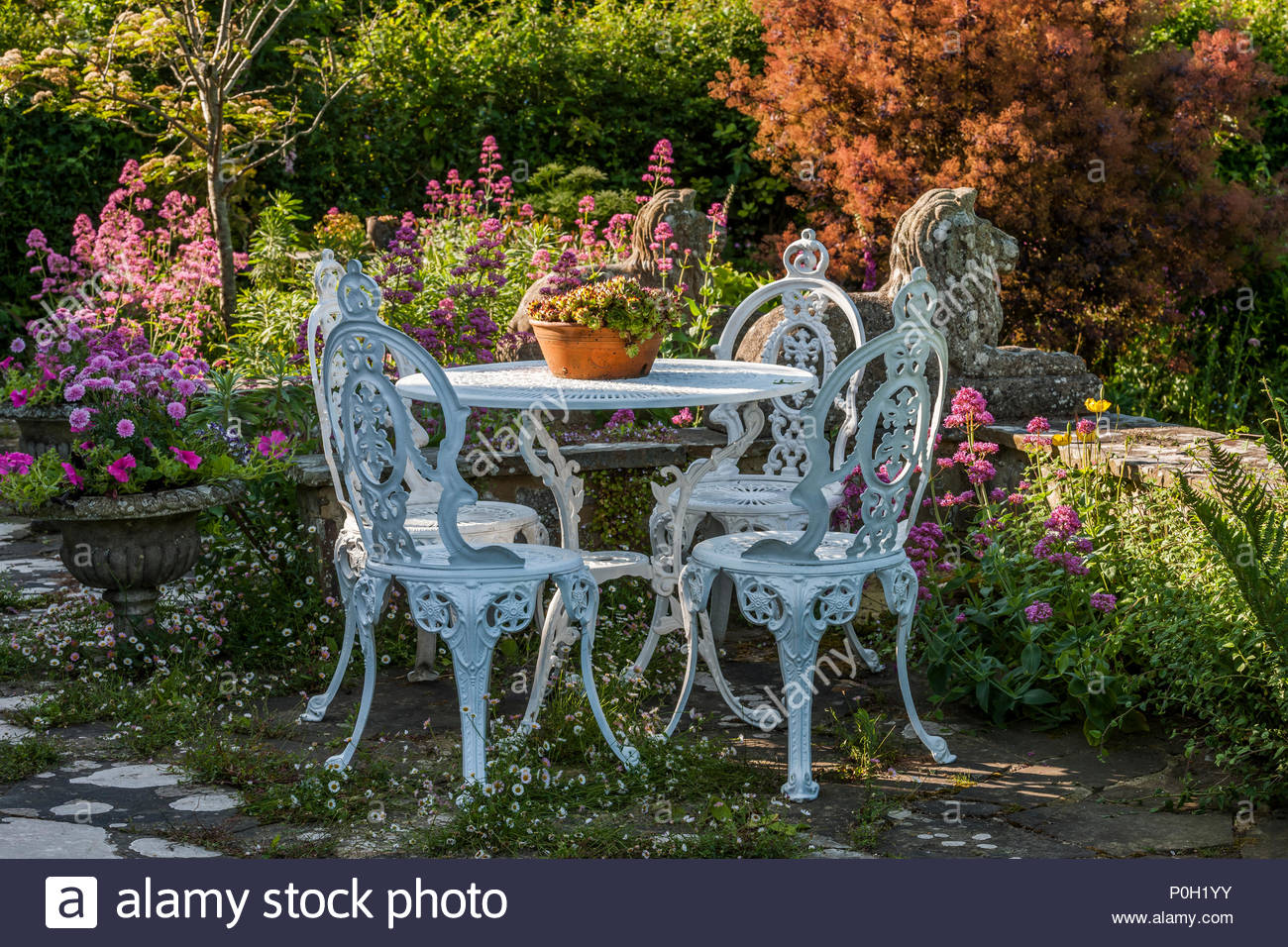 Patio table and chairs at Butlers Farmhouse - Stock Image
