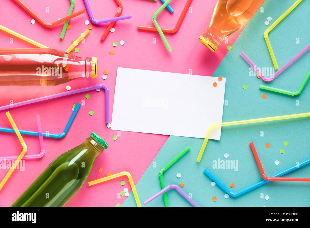Various cold drinks with straws and confetti on pink and blue background and copy space for text. Summer party, happy vacation and fun concept, top vi - Stock Image