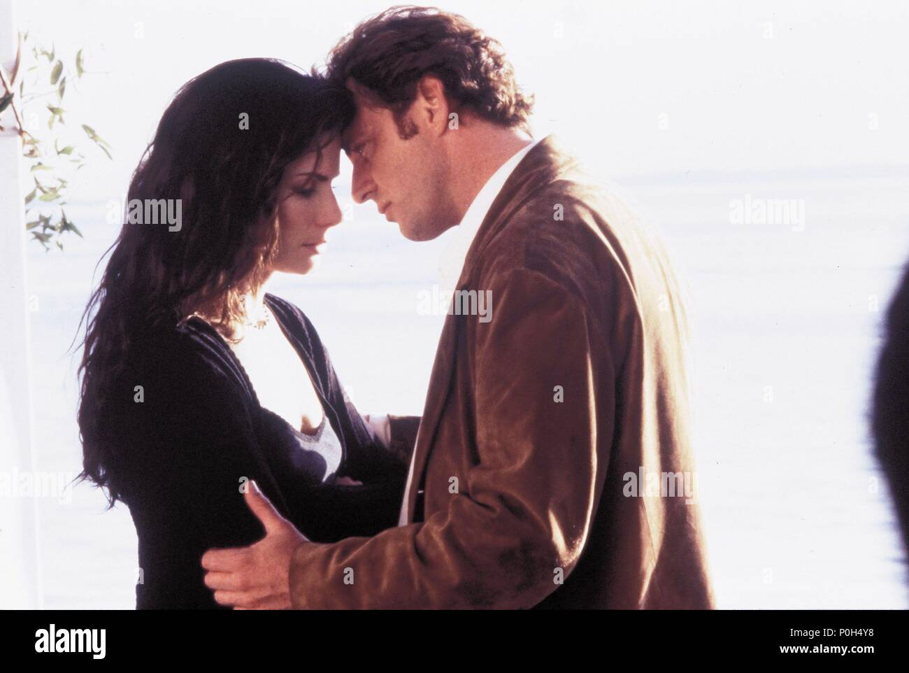 Original Film Title: PRACTICAL MAGIC.  English Title: PRACTICAL MAGIC.  Film Director: GRIFFIN DUNNE.  Year: 1998.  Stars: AIDAN QUINN; SANDRA BULLOCK. Credit: WARNER BROTHERS / TENNER, SUZANNE / Album - Stock Image