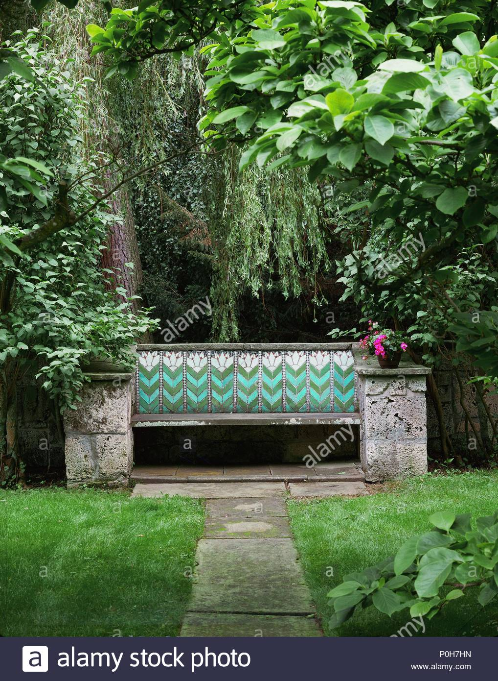Stone bench with tile-design in the garden of House \